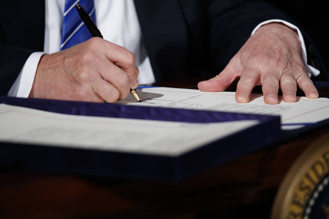 "President Donald Trump signs the ""Department of Veterans Affairs Accountability and Whistleblower Protection Act of 2017"" in the East Room of the White House, Friday, June 23, 20 ..."