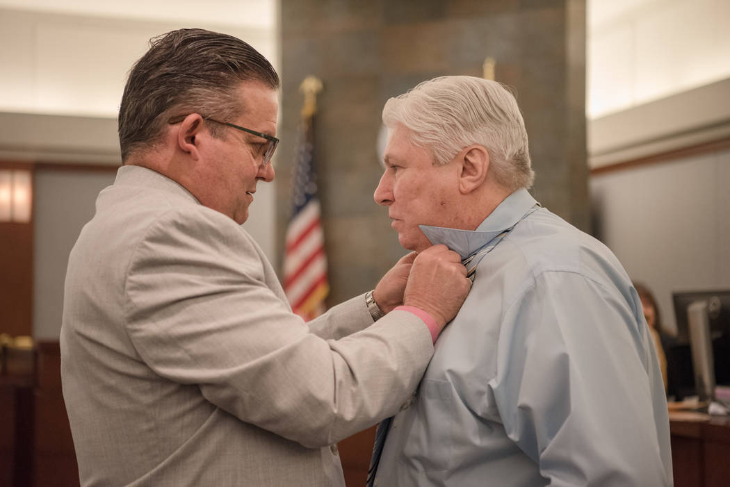 Attorney Clark Patrick helps Thomas Randolph with his tie before trial on Wednesday, June 21, 2017, at Regional Justice Center in Las Vegas. Morgan Lieberman Las Vegas Review-Journal