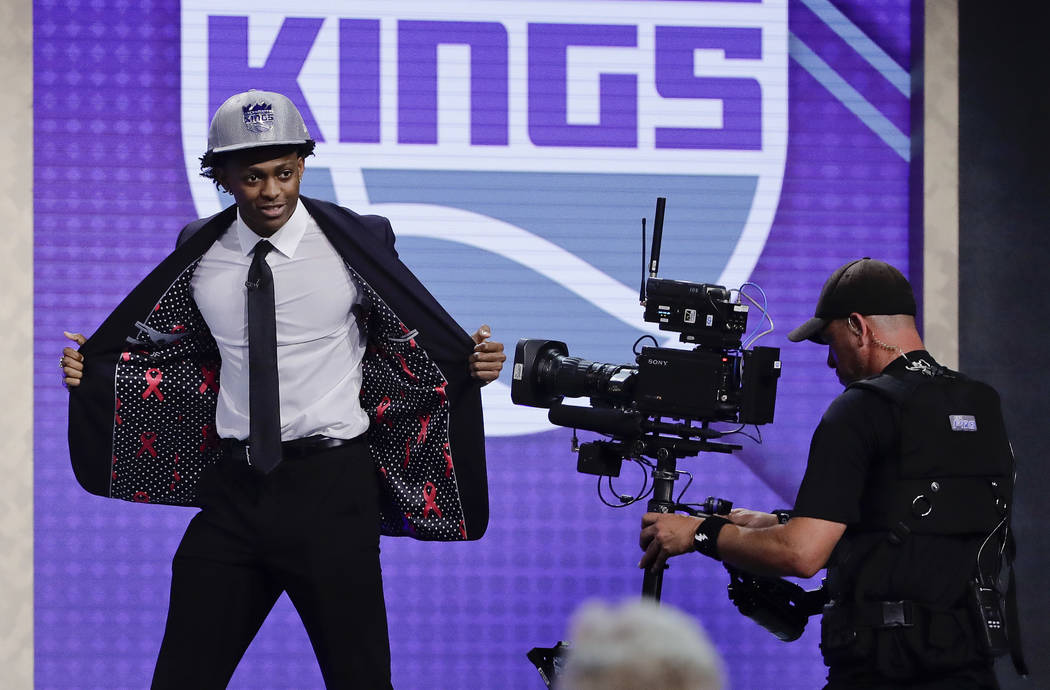 Kentucky's De' Aaron Fox reacts after being selected by the Sacramento Kings as the fifth pick overall during the NBA basketball draft, Thursday, June 22, 2017, in New York. (AP Photo/Frank Frankl ...