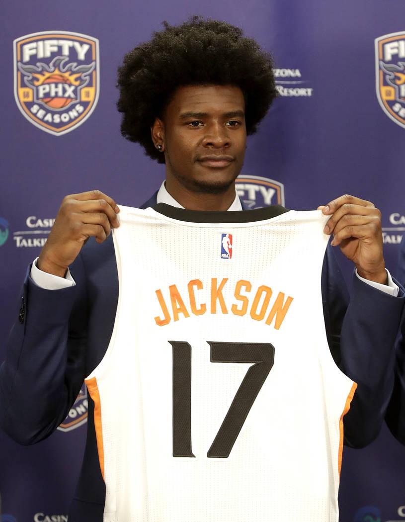 Phoenix Suns first round NBA basketball draft pick Josh Jackson holds his jersey, Friday, June 23, 2017, in Phoenix. (AP Photo/Matt York)