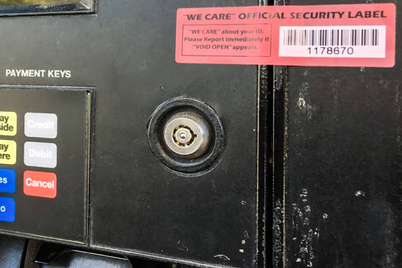 """The red seal tape used to protect gas pump card readers is often replaced with new tape bought from the """"dark web,"""" so Williams said to look for tear marks. (Henderson Police Department)"""