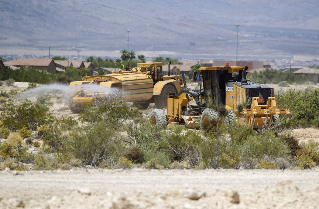 Heavy machinery makes its way through the Villages at Tule Springs project site in North Las Vegas on Monday, June 26, 2017. (Richard Brian/Las Vegas Review-Journal) @vegasphotograph