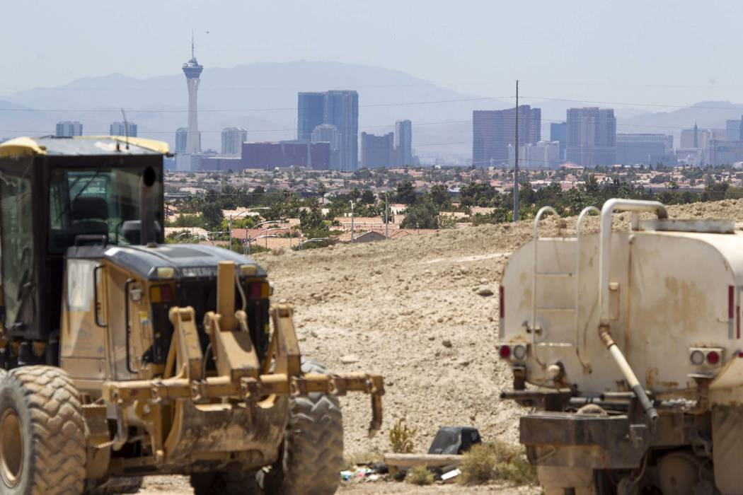 Heavy machinery makes its way through the Villages at Tule Springs project site in North Las Vegas on Monday, June 26, 2017. Richard Brian Las Vegas Review-Journal @vegasphotograph