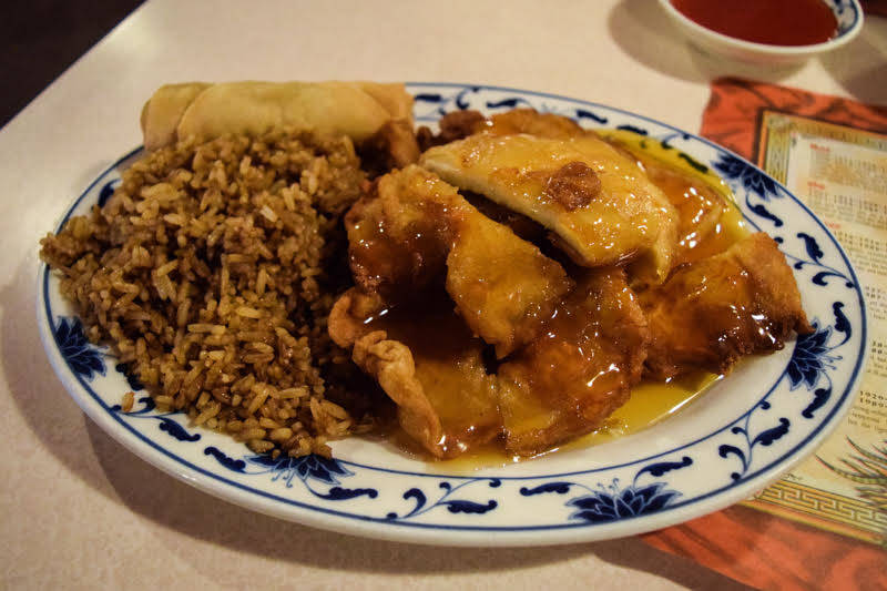 The lemon chicken dish consists of lightly breaded chicken breast with a heavy lemon glaze and a choice of fried rice and an egg roll. (Alex Meyer/View) @alxmey