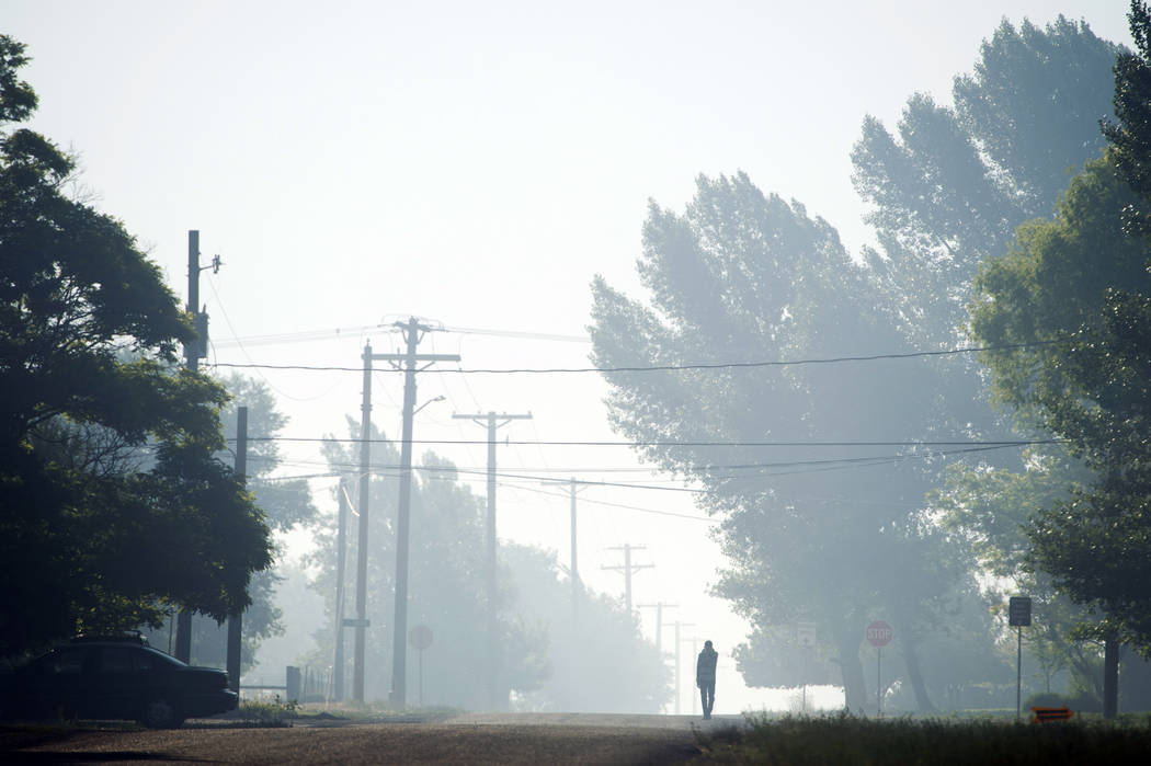 Haze from smoke of the Brian Head fire drifts through the streets of Parowan, Utah, early Thursday, June 22, 2017. (Rick Egan/The Salt Lake Tribune via AP)
