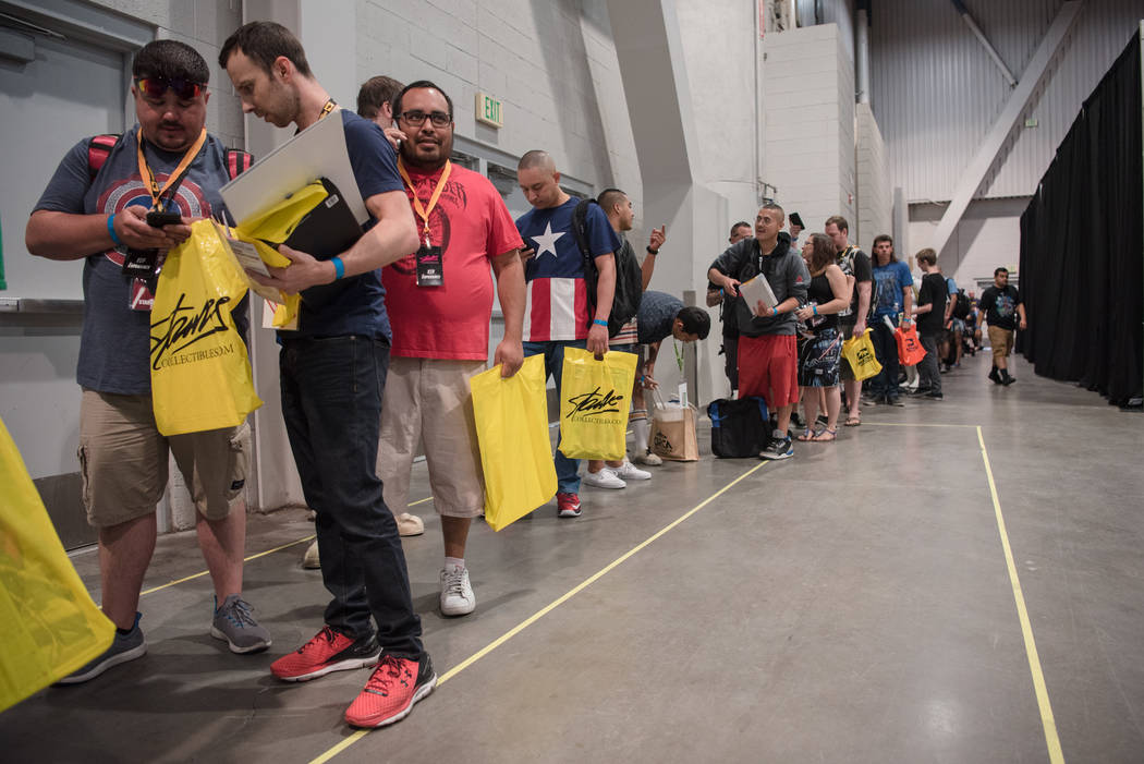 Fans wait in line to receive their photo op with Stan Lee, Marvic comic writer and former publisher, on the opening day of Las Vegas Comic Con on Friday, June 23, 2017, at Las Vegas Convention Cen ...