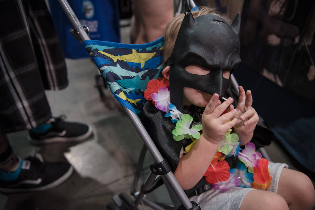 Thorin Denham, finishing a lollipop under a Batman mask, at Las Vegas Comic Con on Friday, June 23, 2017, at Las Vegas Convention Center in Las Vegas. Morgan Lieberman Las Vegas Review-Journal
