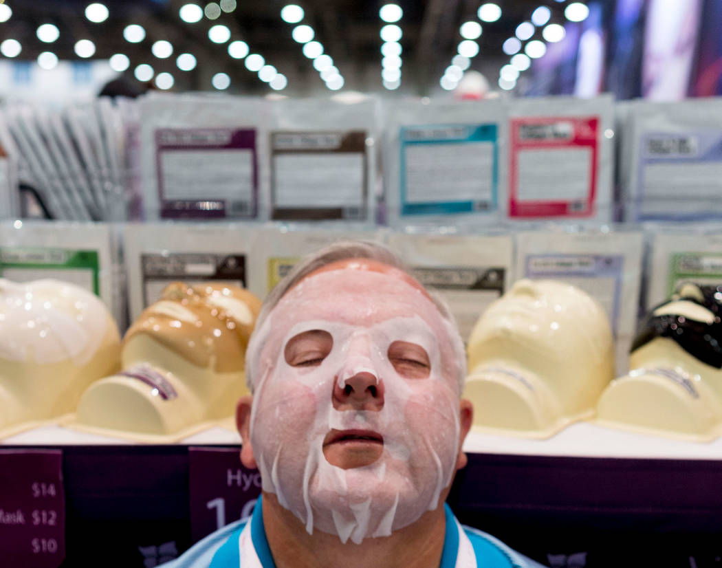 Salon owner Albert Furney tries a Martinni Beauty face mask during the International Esthetics Cosmetics and Spa Conference at the Las Vegas Convention Center in Las Vegas, Sunday, June 25, 2017.  ...