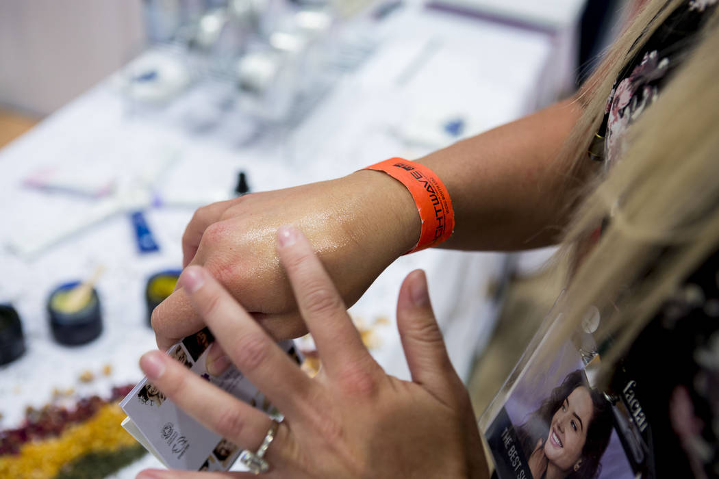 Esthetician Hailey Knight tries Inlight organic skincare products during the International Esthetics Cosmetics and Spa Conference at the Las Vegas Convention Center in Las Vegas, Sunday, June 25,  ...