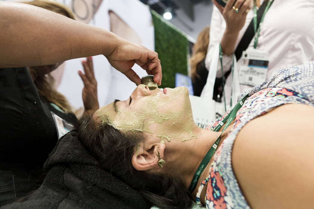 Yesenia Johnson with The Spring luxury resort and spa tests Pure Organic Ice during the International Esthetics Cosmetics and Spa Conference at the Las Vegas Convention Center in Las Vegas, Sunday ...