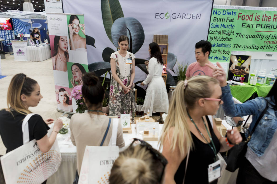 People visit Organic booths during the International Esthetics Cosmetics and Spa Conference at the Las Vegas Convention Center in Las Vegas, Sunday, June 25, 2017. Elizabeth Brumley Las Vegas Revi ...