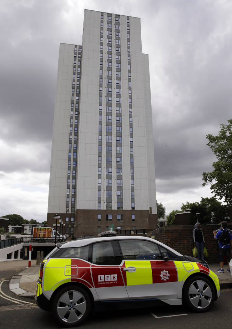 A fire patrol vehicle is parked outside Burnham block, part of the Chalcots Estate in the borough of Camden, north London, Saturday June 24, 2017, after the local council evacuated some 650 homes  ...