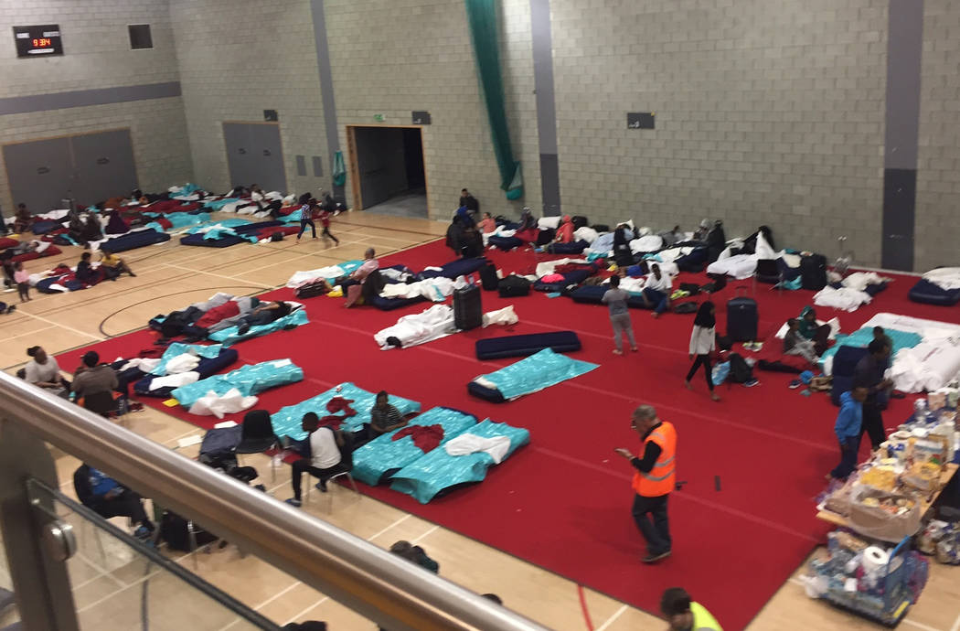 People gather in a leisure centre in Swiss Cottage, north London, Saturday June 24, 2017, after the local council evacuated some 650 homes overnight. (AP)