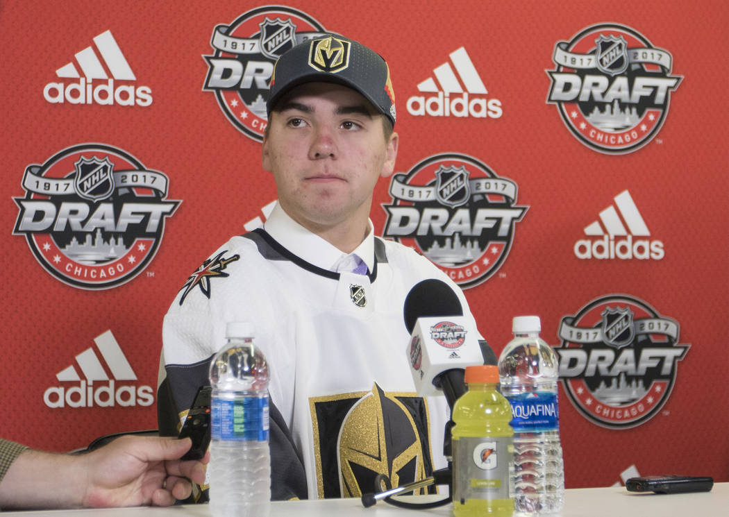 Jonathan Dugan, who was selected 142 overall by the Vegas Golden Knights at the 2017 NHL Entry Draft, takes questions from reporters at the United Center in Chicago, Illinois, on Saturday, June 24 ...