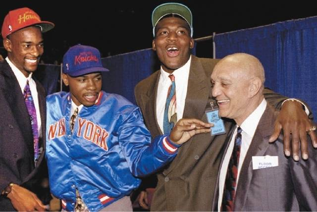 Larry Johnson, second from right, celebrates with UNLV teammates Stacey Augmon and Greg Anthony, and coach Jerry Tarkanian after all three players were selected in the first round of the 1991 NBA  ...