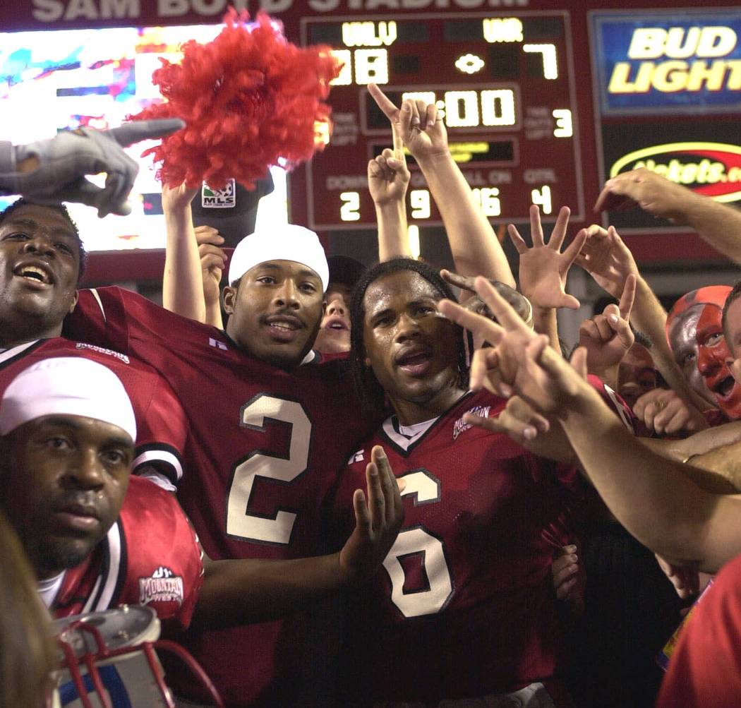 UNLV quarterback Jason Thomas (2) and wide receiver Nate Turner (6) celebrate a 38-7 victory over Nevada with fans on Saturday, Oct. 7, 2000, in Las Vegas. (AP Photo/Jeff Klein)