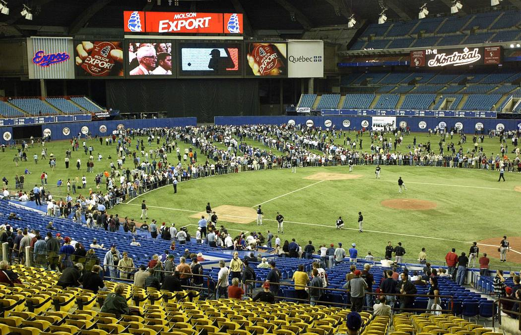 Fans crowd the outfield at Olympic Stadium prior to the Montreal Expos game against the Florida Marlins in Montreal, Wednesday Sept. 29, 2004. Wednesday night's game will be the last home game for ...