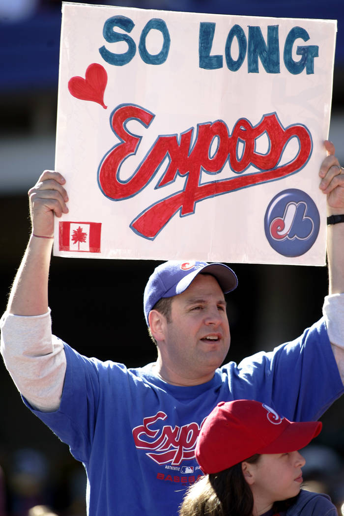 A Montreal Expos fan holds up a sign at the Expos final game as the Montreal Expos against the New York Mets, Sunday, Oct. 3, 2004, at Shea Stadium in New York. (AP Photo/Ed Betz)