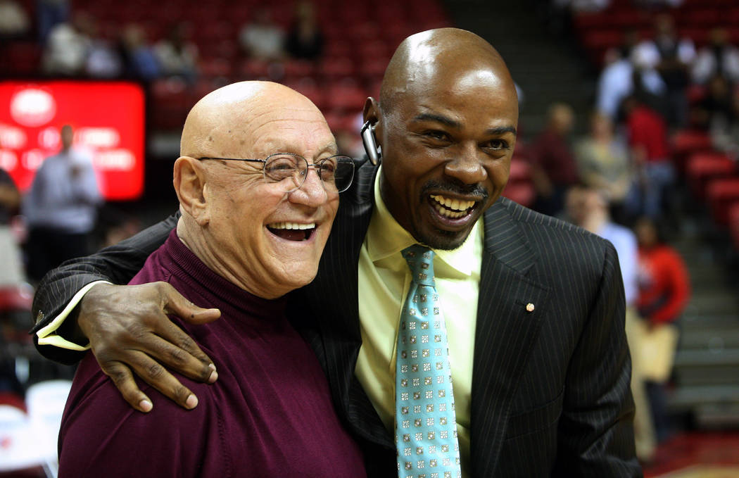 Former Las Vegas basketball coach Jerry Tarkanian, left, greets former player Greg Anthony, right, after the UNLV Alumni game on Tuesday Nov. 7, 2006, at the Thomas & Mack Center in Las Vegas. ...