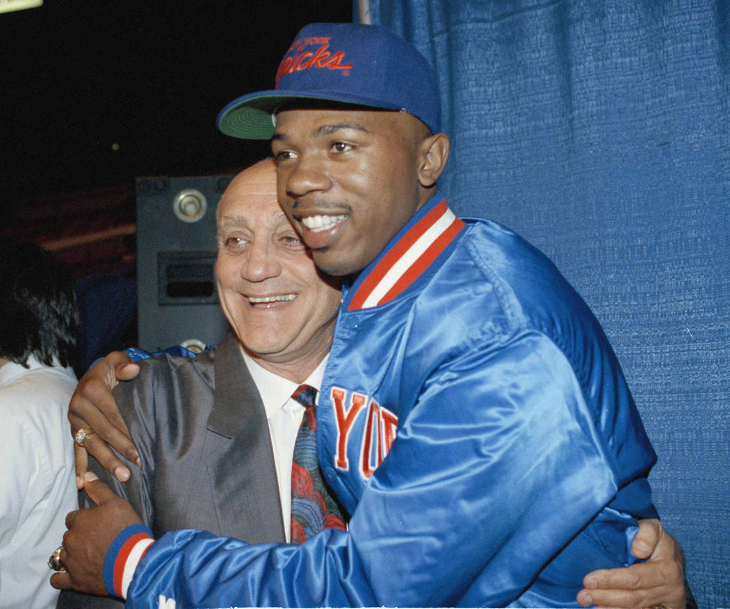 UNLV basketball coach Jerry Tarkanian hugs former UNLV player Greg Anthony after Anthony was chosen by the New York Knicks in the first round of the NBA draft at New York's Madison Square Garden,  ...