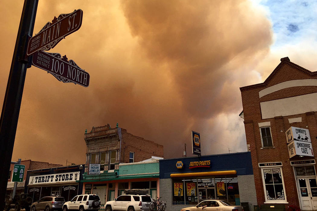 Clouds of smoke from a wildfire approach Panguitch, northeast of Brian Head, Utah, Thursday, June 22, 2017. A wildfire near Brian Head, Utah, that has forced hundreds of people to evacuate has dou ...
