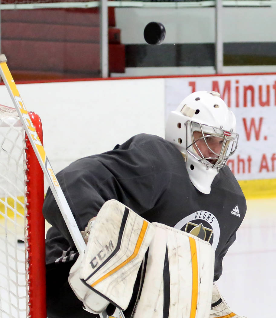 Vegas Golden Knights' goalie Maksim Zhukov deflects the puck away from the goal during the team's development camp at Las Vegas Ice Center in Las Vegas on Thursday, June 29, 2017. Bizuayehu Tesfay ...