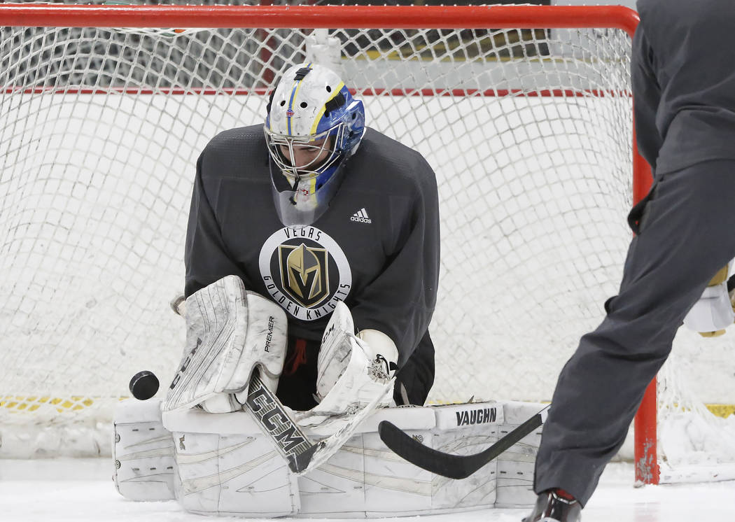 Vegas Golden Knights' goalie Jiri Patera deflects the puck away from the goal during the team's development camp at Las Vegas Ice Center in Las Vegas on Thursday, June 29, 2017. Bizuayehu Tesfaye/ ...