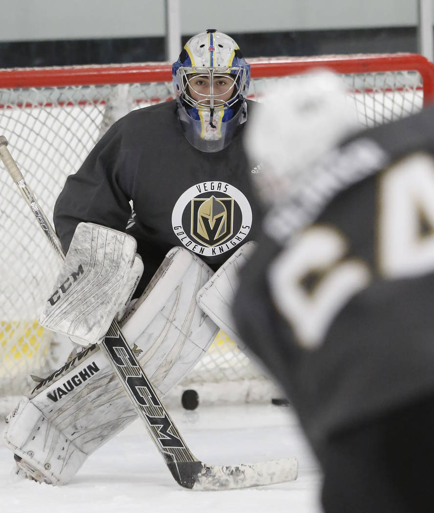 Vegas Golden Knights' goalie Jiri Patera keeps his eye on the puck during the team's development camp at Las Vegas Ice Center in Las Vegas on Thursday, June 29, 2017. Bizuayehu Tesfaye/Las Vegas R ...