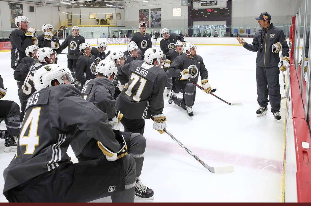 Vegas Golden Knights' players listen to Rocky Thompson, coach for Golden Knights' American Hockey League affiliation, during the team's development camp at Las Vegas Ice Center in Las Vegas on Thu ...