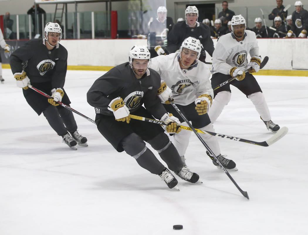 Vegas Golden Knights' Alex Barre-Boulet, right, chases down the puck against Nikolas Brouillard during a scrimmage as part of the team's development camp at Las Vegas Ice Center in Las Vegas on Fr ...