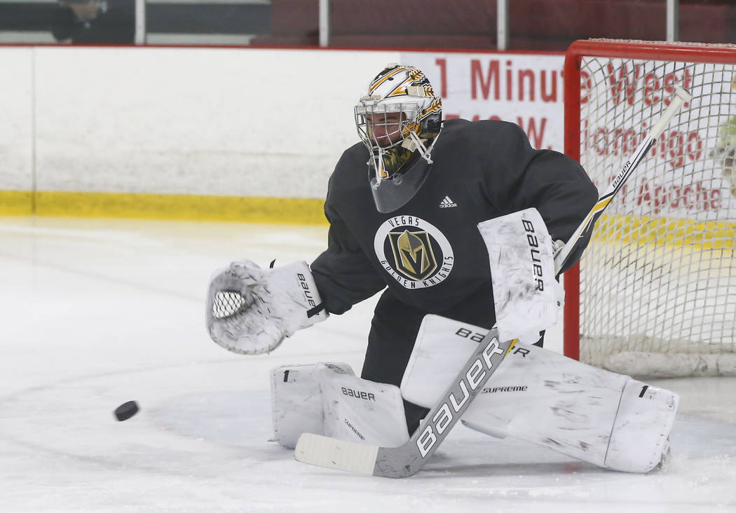 Vegas Golden Knights' Logan Thompson reaches out to block a shot during a scrimmage as part of the team's development camp at Las Vegas Ice Center in Las Vegas on Friday, June 30, 2017. Chase Stev ...