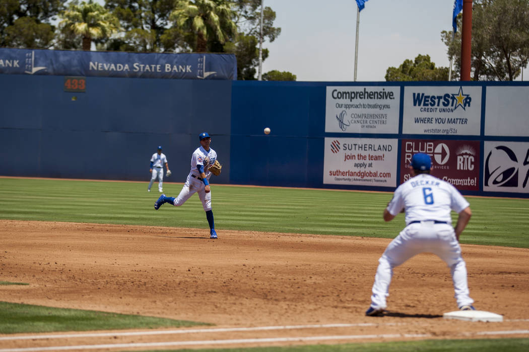 The 51s' Gavin Cecchini throws the ball to Cody Decker to make a play at first against the Salt Lake Bees at Cashman Field on Sunday, June 25, 2017.  Patrick Connolly Las Vegas Review-Journal @PCo ...