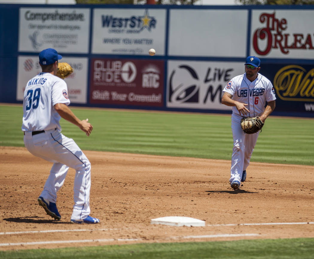 Cody Decker throws the ball to Las Vegas 51s pitcher Las Vegas 51s pitcher Mitch Atkins to make a play against the Salt Lake Bees at Cashman Field on Sunday, June 25, 2017.  Patrick Connolly Las V ...