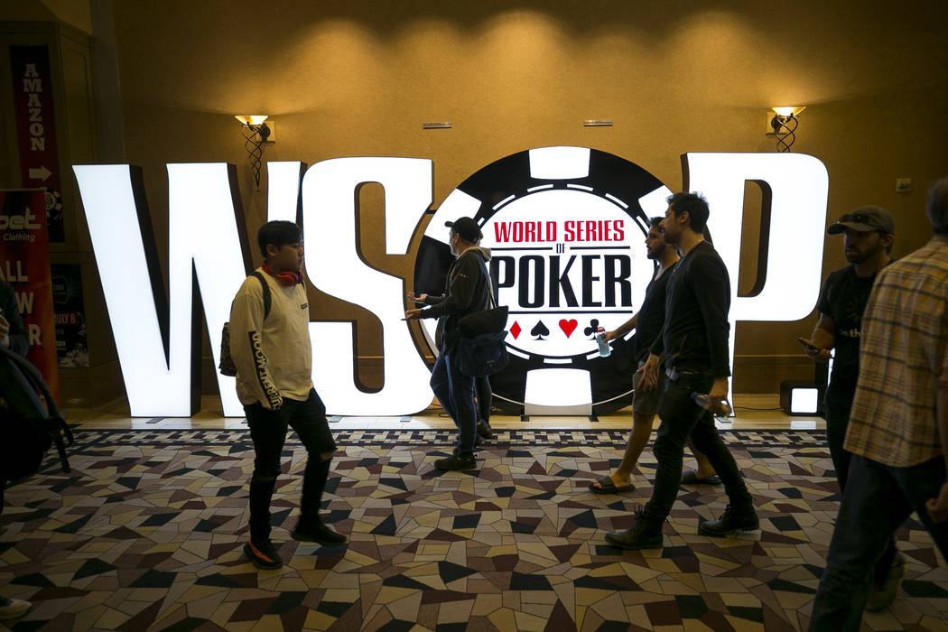 People walk past a WSOP display during the World Series of Poker on Monday, June 26, 2017, at the Rio hotel-casino, in Las Vegas. (Richard Brian/Las Vegas Review-Journal) @vegasphotograph