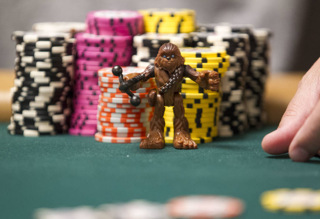 A poker player keeps a Chewbacca figurine by his chips as a good luck charm during the World Series of Poker on Monday, June 26, 2017, at the Rio hotel-casino, in Las Vegas. (Richard Brian/Las Veg ...