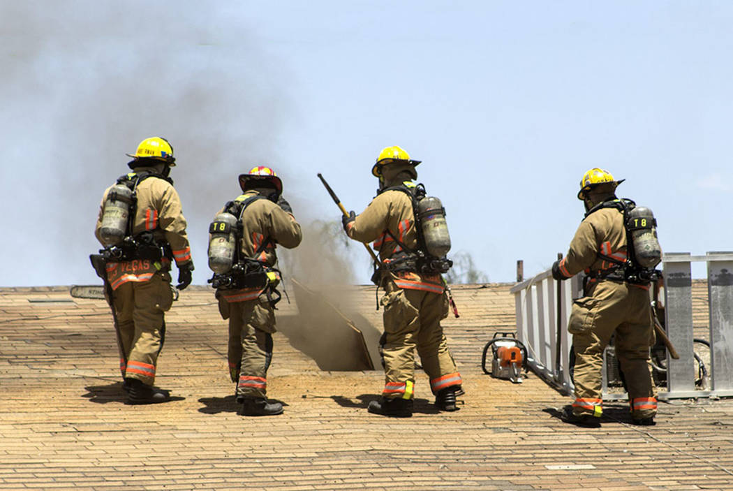 Firefighters battle a fire at Charleston Garden Apartments, 4850 E. Charleston Blvd., on Sunday. (Dave Butcher)