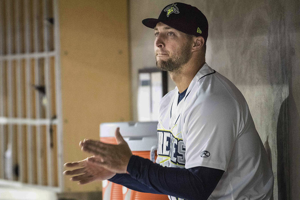 Columbia Fireflies outfielder Tim Tebow applauds from the dugout during a minor league baseball game against the Augusta GreenJackets in Columbia, S.C., in April. (AP Photo/Sean Rayford, File)