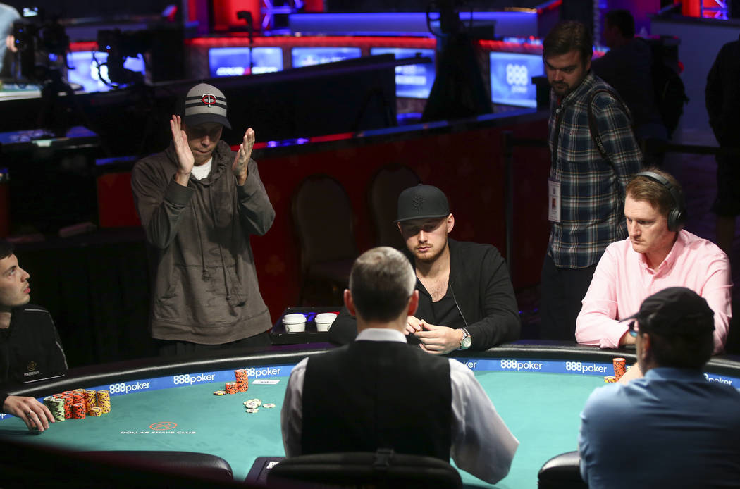 Carson City resident Ian Steinman, left, reacts while competing in the $1,500 No-Limit Hold'em event during the World Series of Poker at the Rio hotel-casino in Las Vegas on Thursday, June 29, 201 ...