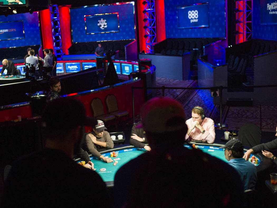 Carson City resident Ian Steinman, lower left, competes in the $1,500 No-Limit Hold'em event during the World Series of Poker at the Rio hotel-casino in Las Vegas on Thursday, June 29, 2017. Chase ...