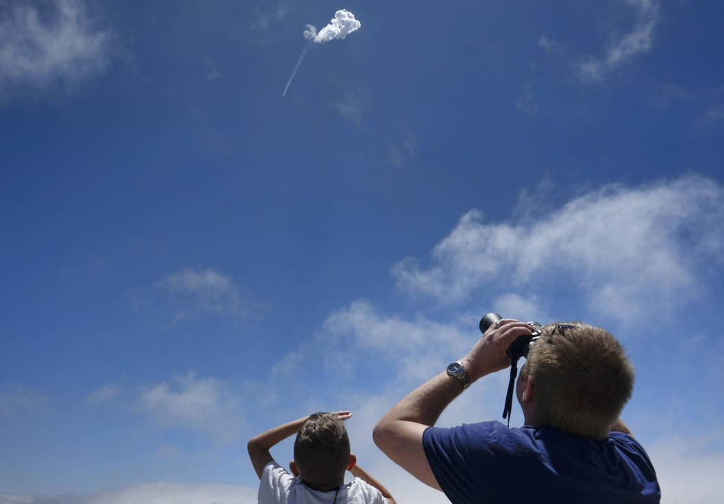 Spectators watch as a SpaceX Falcon 9 rocket heads skyward after being launched at the Vandenberg Air Force Base, Calif., on Sunday, June 25, 2017. (AP Photo/Richard Vogel)