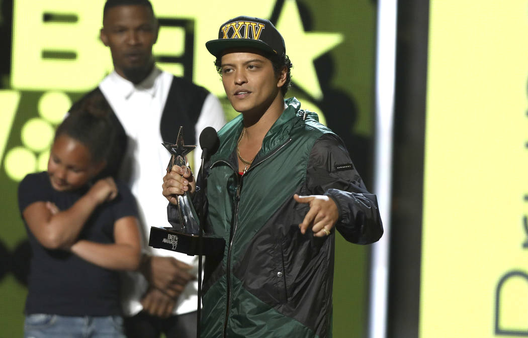Bruno Mars accepts the award for best male R&B/pop artist at the BET Awards at the Microsoft Theater on Sunday, June 25, 2017, in Los Angeles. (Matt Sayles/Invision/AP)