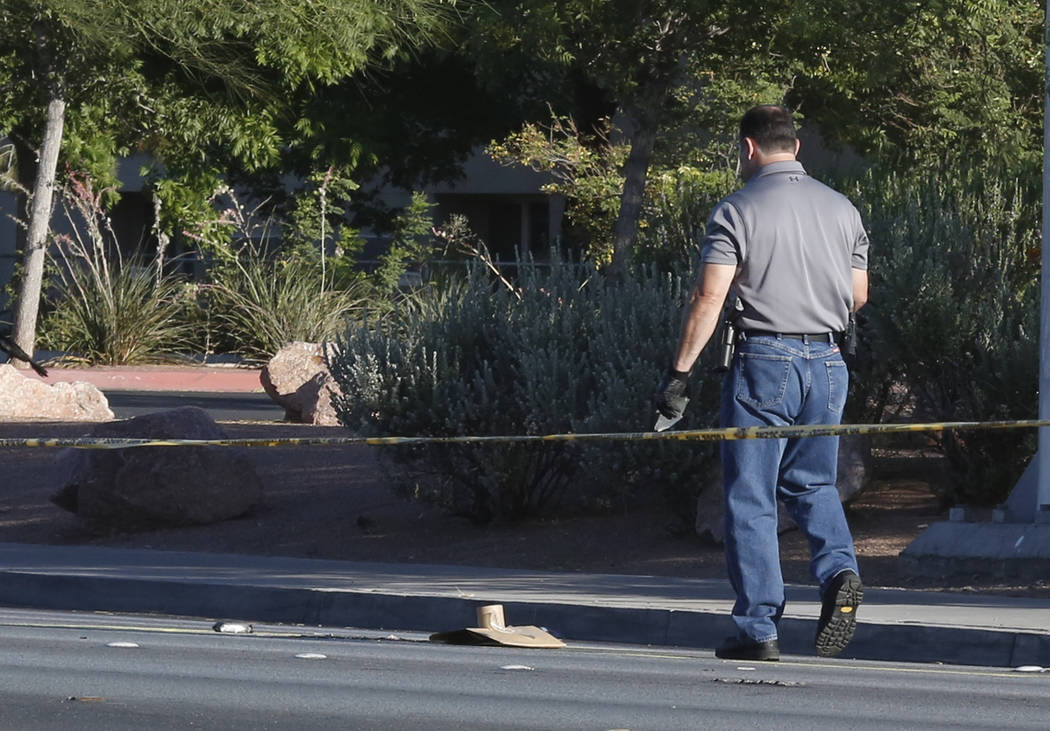 A detective investigates after a pedestrian died after being struck by an SUV near Tropicana Avenue and Maryland Parkway early Monday morning, June 26, 2017. (Bizuayehu Tesfaye/Las Vegas Review-Jo ...