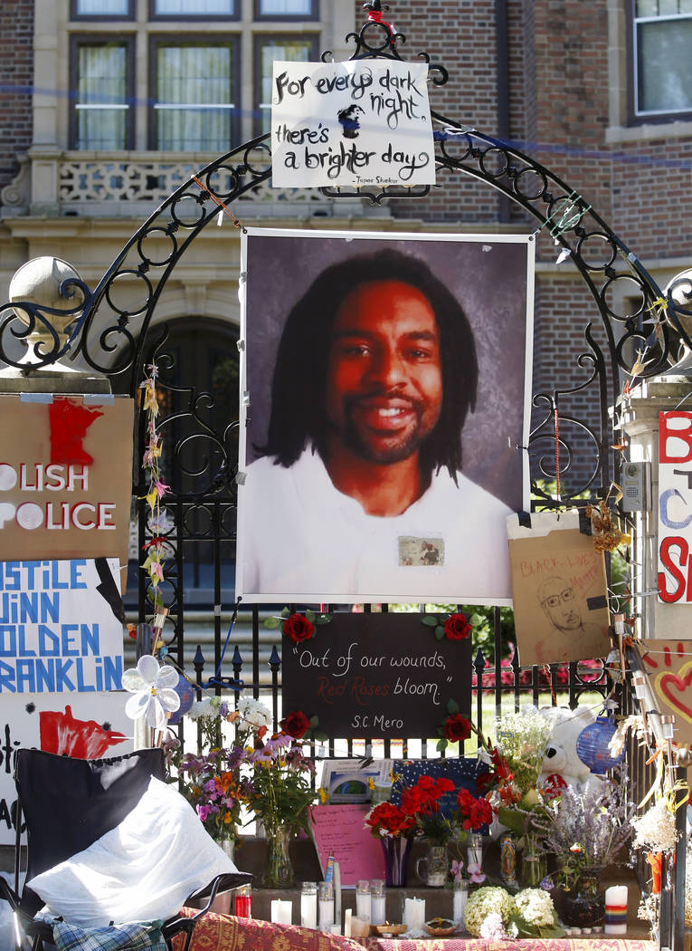 A memorial including a photo of Philando Castile adorns the gate to the governor's residence in St. Paul, Minn., on  July 25, 2016, protesting the July 6, 2016, shooting death of Castile by St. An ...