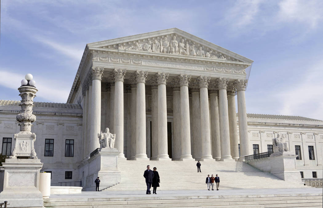 FILE - This Jan. 25, 2012, file photo, shows the U.S. Supreme Court Building in Washington. The Supreme Court enters its final week of work before a long summer hiatus with action expected on the  ...