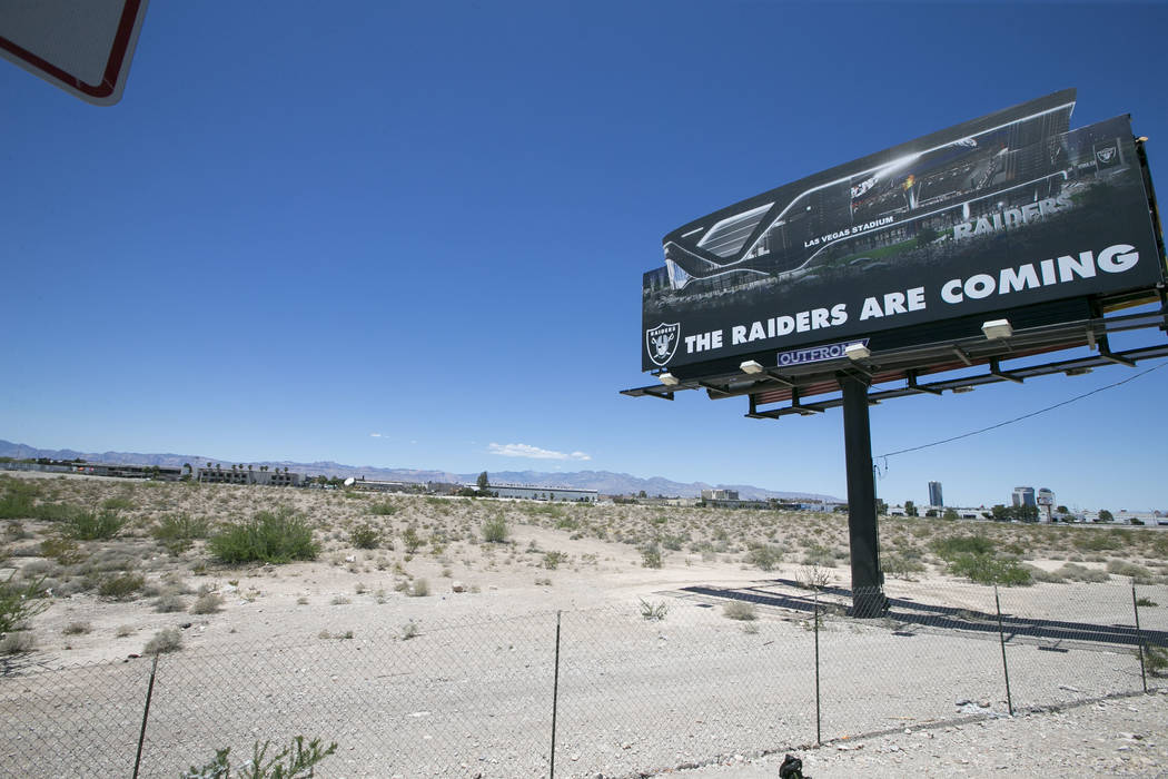 A billboard advertising the Raiders at the proposed stadium site near Russell Road and Dean Martin Drive on Sunday, May 28, 2017. (Richard Brian/Las Vegas Review-Journal) @vegasphotograph