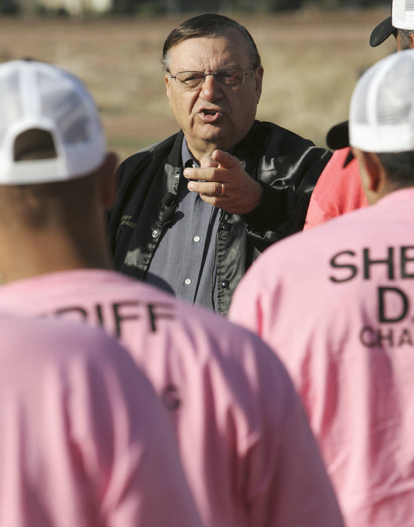 Maricopa County Sheriff Joe Arpaio addresses members of a chain gang in Phoenix, Dec. 11, 2007. The former longtime sheriff of metro Phoenix will go to court Monday, June 26, 2017, to defend his r ...