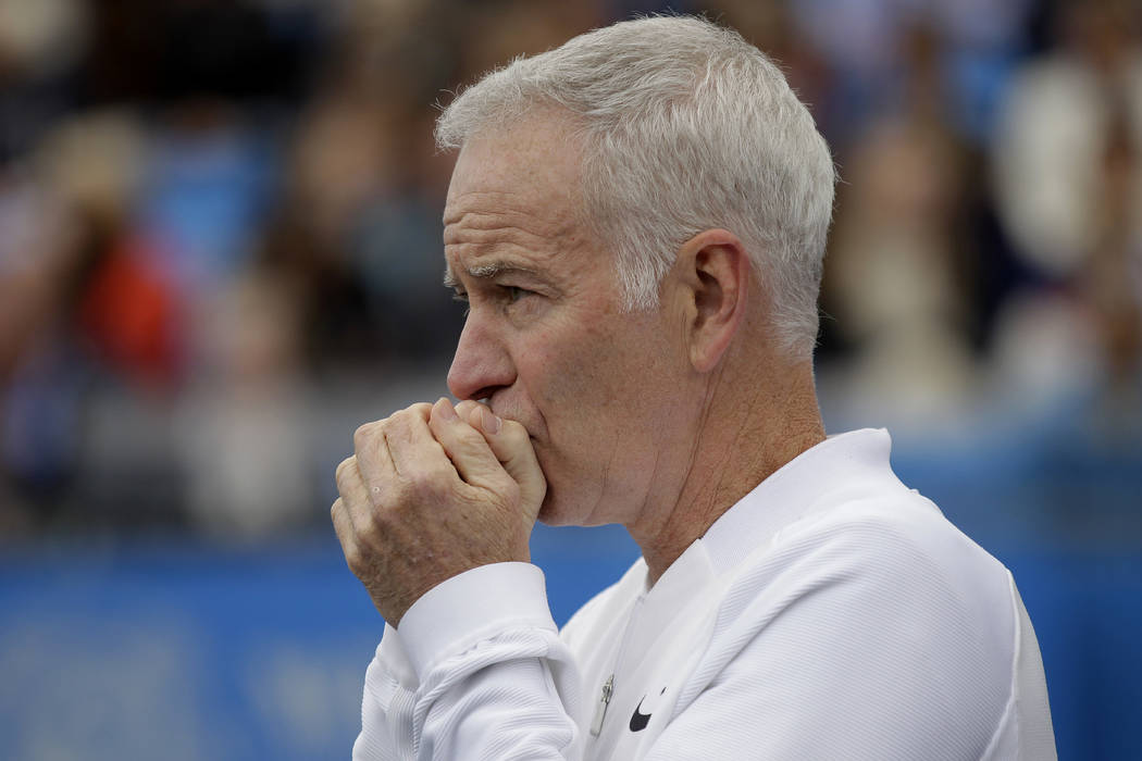 In a  Saturday June 18, 2016 file photo, John McEnroe, Coach to Canada's Milos Raconic, looks across the court as Raconic plays Australia's Bernard Tomic during their semifinal tennis match on the ...