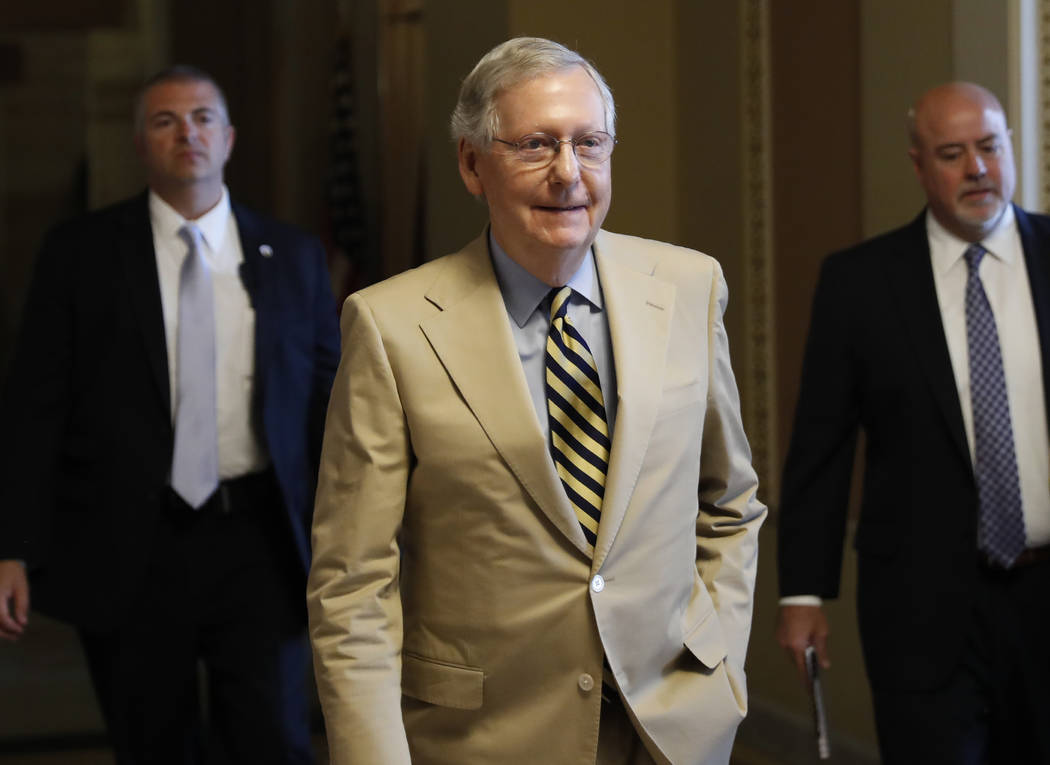 Senate Majority Leader Mitch McConnell of Ky. walks from his office on Capitol Hill in Washington, Monday, June 26, 2017. Senate Republicans unveil a revised health care bill in hopes of securing  ...