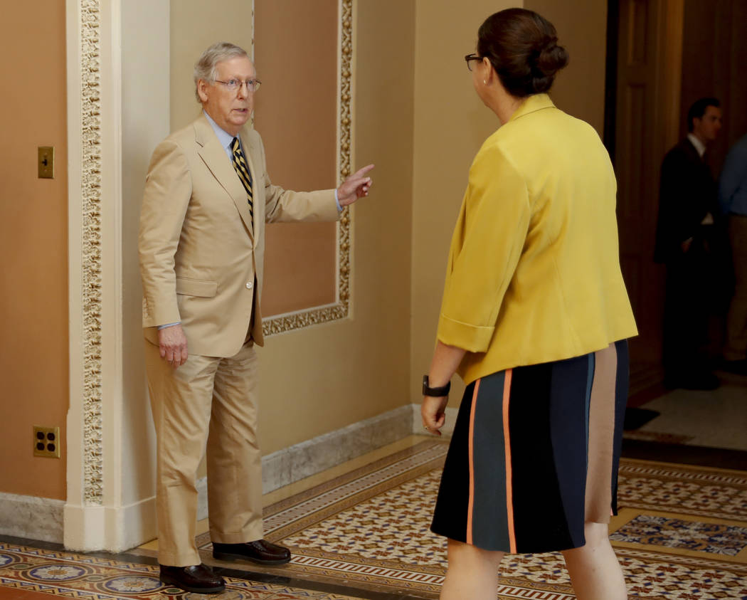 Senate Majority Leader Mitch McConnell of Ky., talks with Secretary for the Majority Laura Dove, as he walks to his office on Capitol Hill in Washington, Monday, June 26, 2017. Senate Republicans  ...