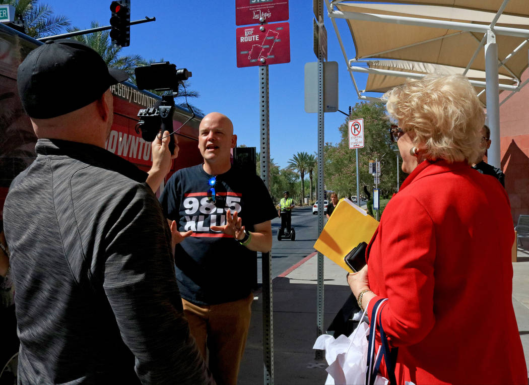 Morning Zoo radio show host Chet Buchanan, left, does a Facebook Live video with Mayor Carolyn Goodman, right, at the Premium Outlets stop for the Downtown Loop, Tuesday, June, 27 2017. Gabriella  ...